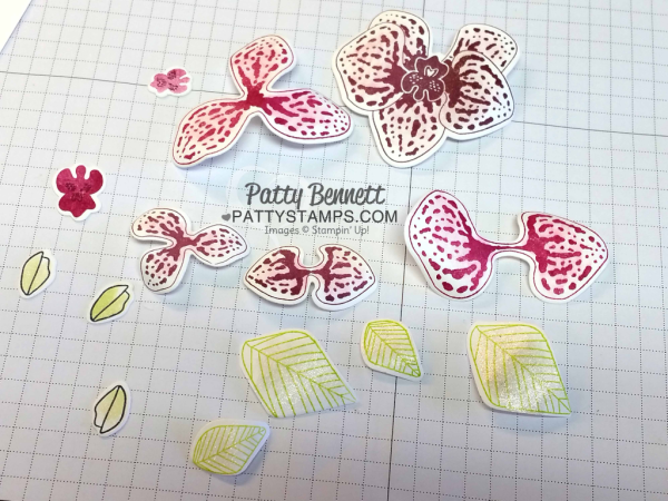 Die Cut pieces to assemble the climbing orchid flowers from Stampin' Up!. Curl each petal with a bone folder and color with clear wink of stella!