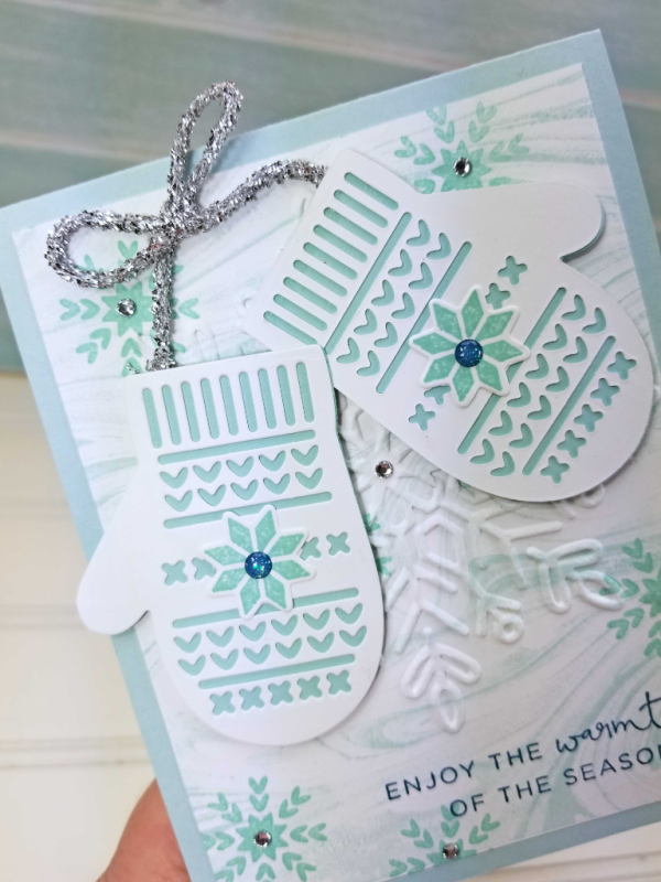 Smitten Mittens snowflake card featuring Stampin' Up! holiday catalog stamps and embossing folder by Patty Bennett