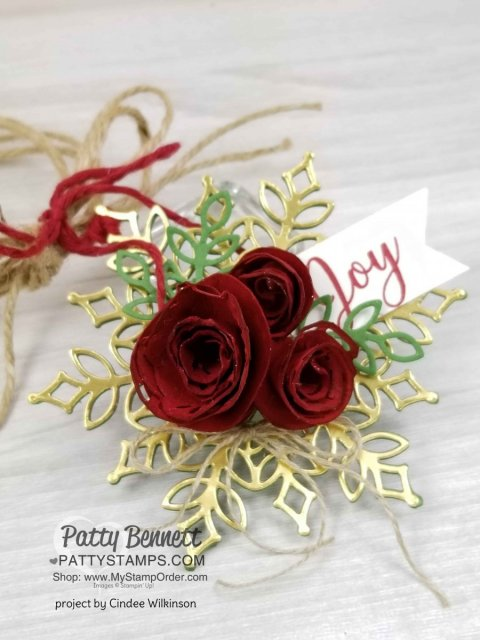 Snowfall Snowflake thinlit dies from Stampin' UP! paired with handmade paper flower rosettes. Perfect package tag or Christmas Tree ornament. Created by Cindee Wilkinson