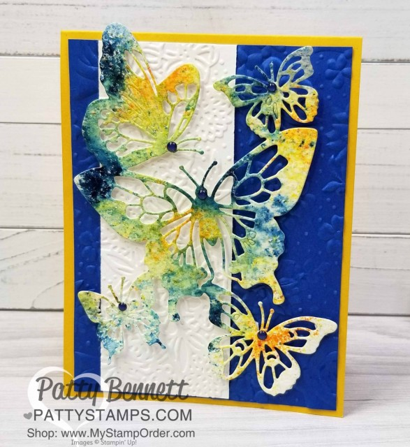 Stampin' UP! Butterfly Beauty framelit die cut layered onto Perfect Pair and Country Floral embossing folder background. Handmade card featuring Brusho watercolor technique by Patty Bennett. www.PattyStamps.com
